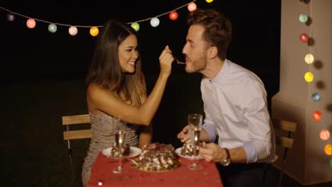 Loving-young-woman-feeding-her-boyfriend