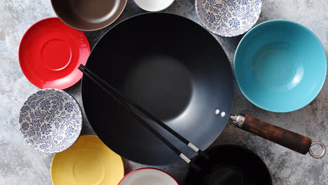Traditional-empty-black-iron-wok-pan-placed-on-stone-background