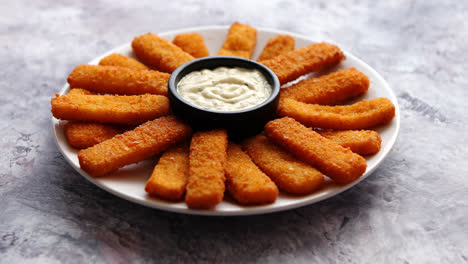 Crumbed-fish-sticks-served-with-garlic-dip-sauce
