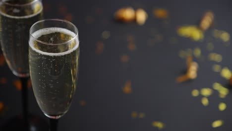 Two-glasses-full-of-sparkling-champagne-wine-with-golden-decoration