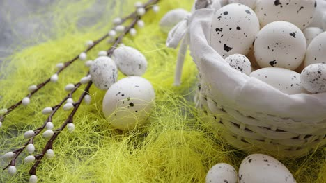 Easter-white-dotted-Eggs-in-the-nest-and-spring-yellow-grass