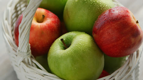Red-and-green-apples-in-basket-