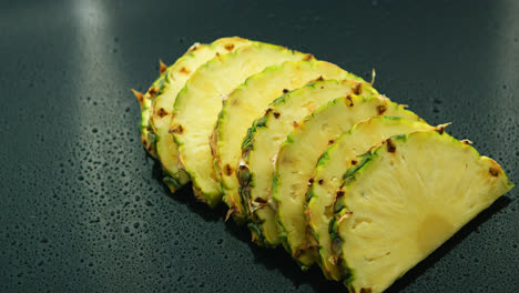 Slices-of-fresh-pineapples-in-row