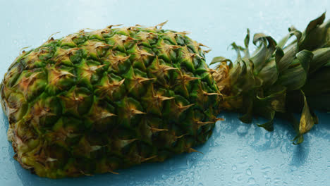 Half-of-pineapple-on-wooden-table-