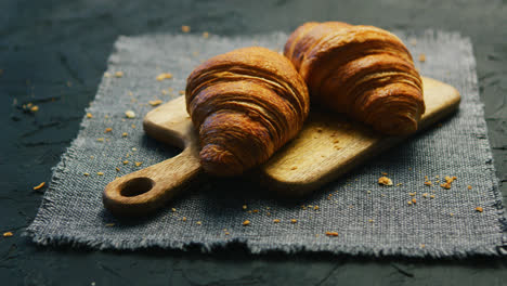 Fresh-croissants-on-chopping-board