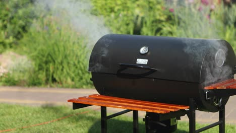 Smokng-barbecue-grill-in-the-garden