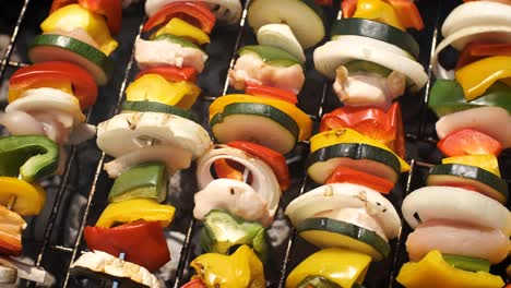 Multiple-colorful-and-tasty-grilled-shashliks-on-outdoor-summer-barbecue