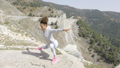 Flexible-woman-in-sportswear-stretching-body