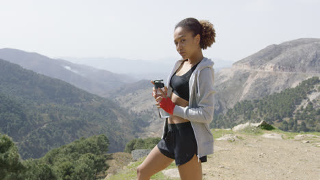Sporty-female-posing-with-bottle-of-water