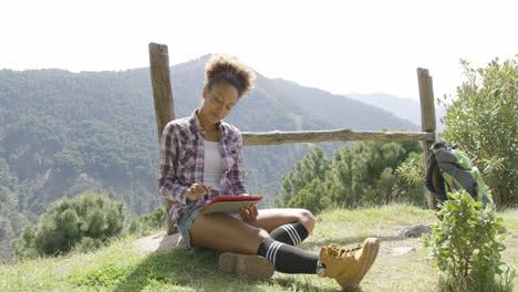 Delightful-young-backpacker-with-tablet