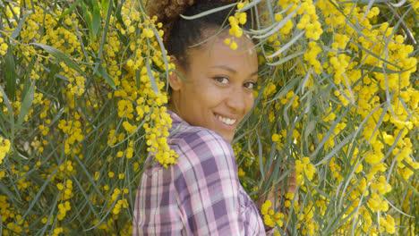 Young-beautiful-woman-posing-in-trees