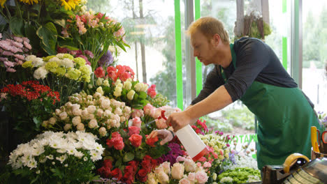 Man-working-in-floral-shop-