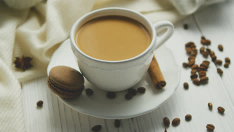 Cup-of-coffee-with-cookie-and-cinnamon