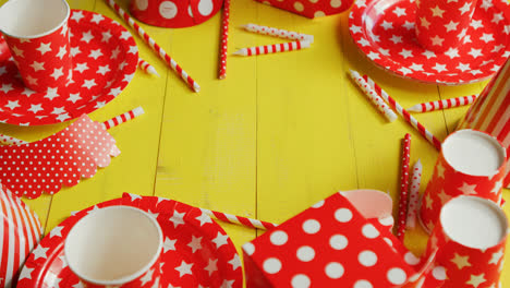 Festive-paper-plates-and-cups-laid-in-circle