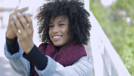 Young-black-woman-taking-selfie