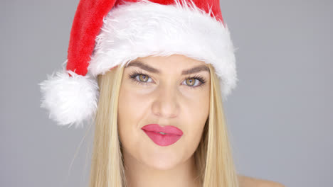Close-up-portrait-of-beautiful-blond-girl-in-Santa-Claus-Hat