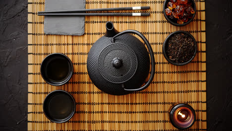 Asian-green-tea-set-on-bamboo-mat