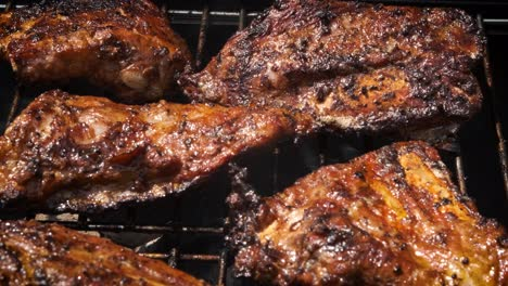 Tasty-ribs-cooking-on-barbecue-grill-for-summer-outdoor-party