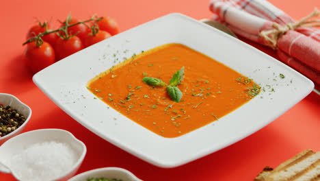 Tomato-soup-in-plate-with-green-leaf