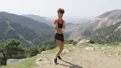 Fit-boxing-woman-looking-aggressive
