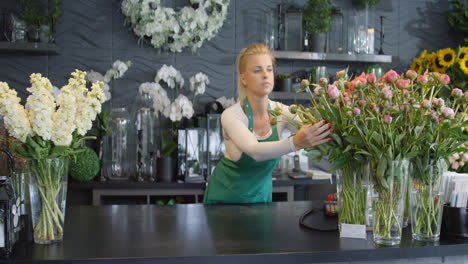 Woman-arranging-bouquets