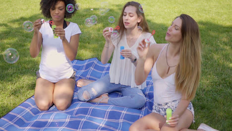 Young-women-blowing-bubbles