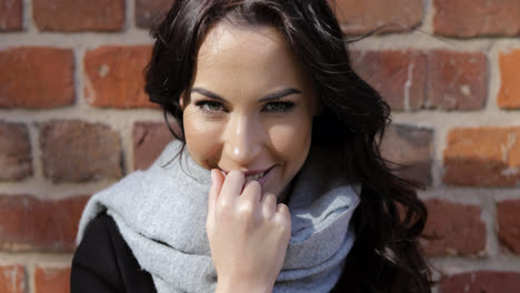 Smiling-woman-in-gray-scarf