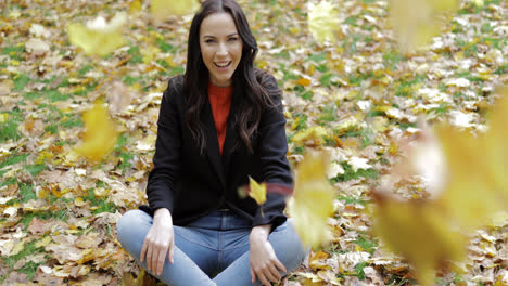 Happy-woman-and-falling-leaves