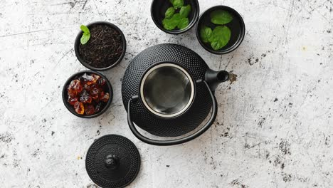 Traditional-eastern-metal-teapot-and-iron-cups