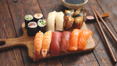 Sushi-Set-Different-kinds-of-sushi-rolls-on-wooden-serving-board