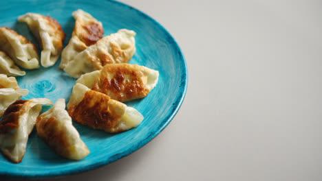 Traditional-asian-dumplings-Gyozas-on-turqoise-ceramic-plate
