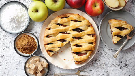 Delicious-apple-pie-cake-with-a-fresh-fruits-brown-and-powder-sugar