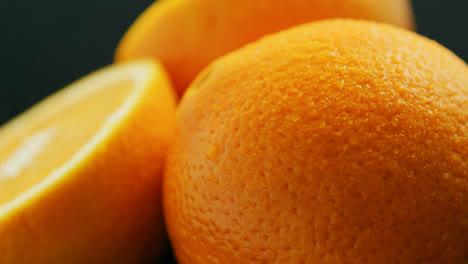 Closeup-whole-and-cut-orange-