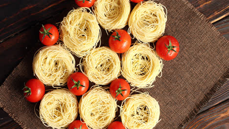 Uncooked-pasta-bunches-and-tomatoes