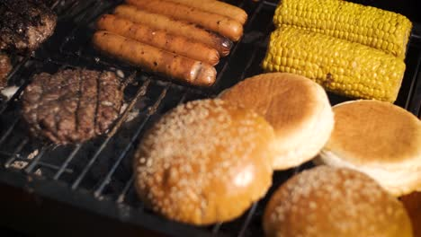 Mixed-american-barbecue-food-on-hot-grill