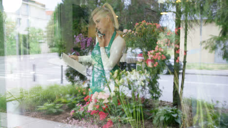Woman-in-floral-shop-talking-phone