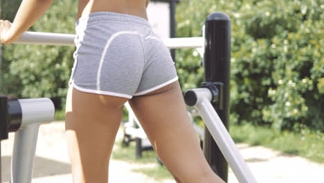 Crop-hips-of-training-woman