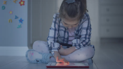 Girl-with-tablet-sitting-on-floor