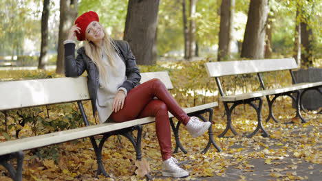 Woman-in-leather-jacket-sitting-on-bench