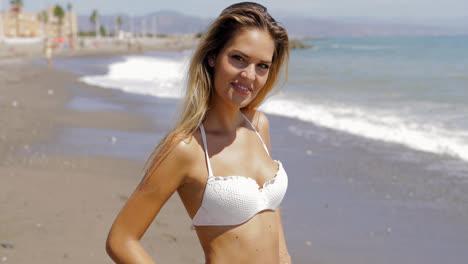 Model-in-swimsuit-posing-on-beach