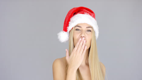 Pretty-young-woman-posing-in-Santa-Claus-Hat