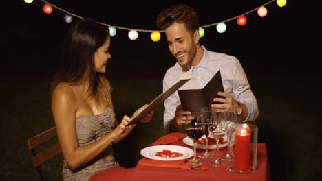 Loving-young-couple-choosing-food-off-a-menu