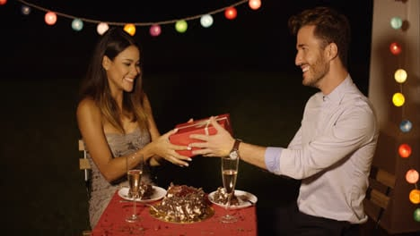 Happy-young-woman-receiving-a-Valentines-gift