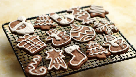 Fresh-baked-Christmas-shaped-gingerbread-cookies-placed-on-steel-grill