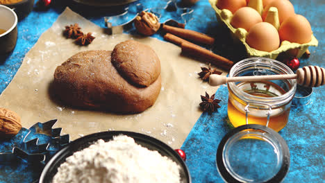 Gingerbread-dough-placed-among-various-ingredients-Christmas-baking-concept