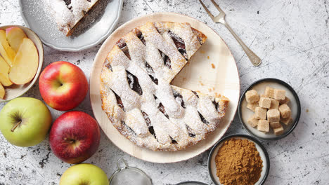 Fresh-baked-apple-pie-with-cutted-slice-on-small-plate