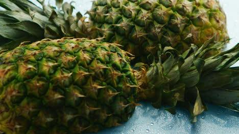 Halves-of-unpeeled-pineapples