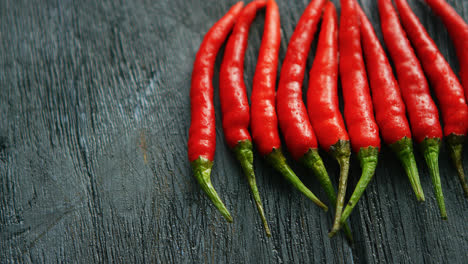 Composed-row-of-red-chili-peppers