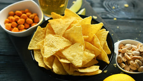Plate-of-corn-chips-with-nuts