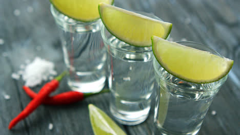 Served-shots-with-tequila-and-lime-slices